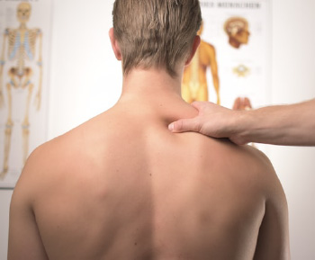 hand reaching to massage back of patient